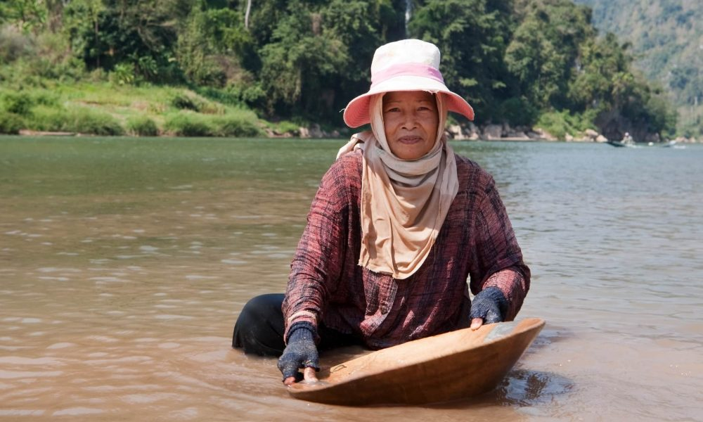 woman washing gold in river, portrait of asian at nam ou in Laos