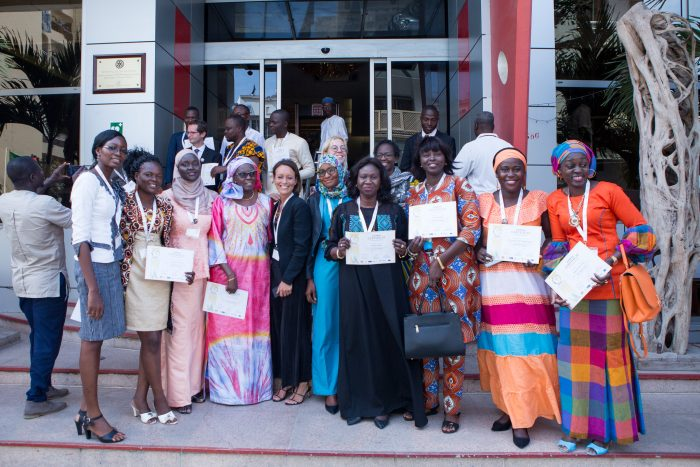 A photograph of ASM workshop participants proudly holding their certificates.
